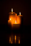 Candle lights. Group of candle lights on a wood table with reflection in darkness,check also stock image