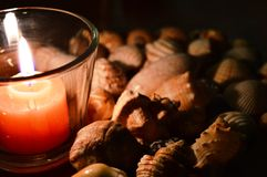 Candle lights. Candlelight illuminating shells. Relax, spa Stock Photo