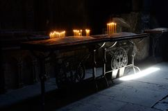 Candle lights in a church,Geghard monastery,Armenia Royalty Free Stock Images