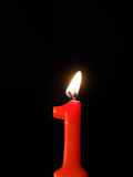 Candle lights. Number 1, candle against black background Royalty Free Stock Image