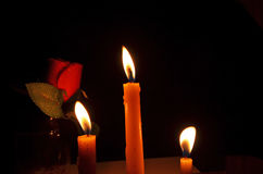 Candle lights with red rose. At dark night Stock Photos
