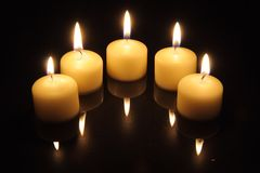 Candle lights with reflections Royalty Free Stock Photos