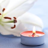 Candle and lily Royalty Free Stock Image