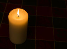 Candle lir against dark background with copy space Royalty Free Stock Photo