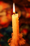 Candle lit. With flame and golden light Stock Photography