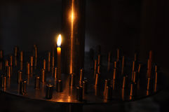 Candle lit in the church Stock Photography