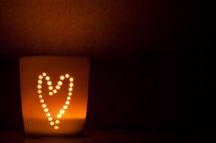 Candle lit cup. Stock Photography