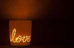 Candle lit cup. Royalty Free Stock Photography