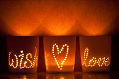Candle lit cups. Stock Photos