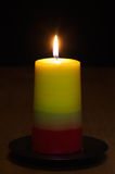 Candle lit in the dark - craft candles series Royalty Free Stock Photography