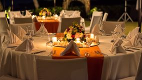 Candle lit outdoor table setting at function