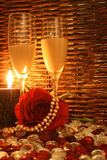 Candle lit Proposal. Romantic Dim Lit Restaurant setting with rose and pearls and candle Royalty Free Stock Image