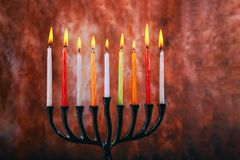 Candle lite on the traditional Silver Hanukkah menorah. Candle lite on the traditional Silver menorah Hanukkah Jewish holiday stock image