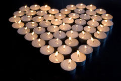 Candle Love. Group of Candles place in the shape of a heart Royalty Free Stock Photos