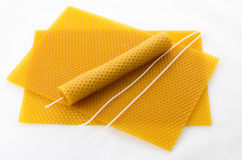 Candle made of beeswax. On honeycomb - background stock image