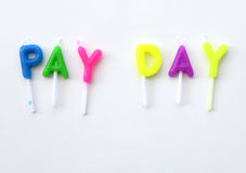 Candle made of word Pay Day. (financial concept) Royalty Free Stock Photos