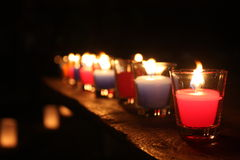 Candle. Many color candle in the dark Royalty Free Stock Photography