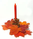 Candle with maple leafs Royalty Free Stock Photography