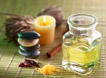 Candle, massage oil and other. Still life with massage oil in the spa salon royalty free stock photos