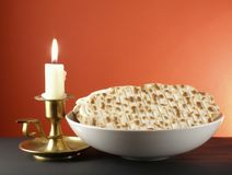 Candle and matzoh. Candle and a plateful of matzoh - jewish passover bread stock image