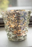 Candle in a mercury glass votive Stock Photo