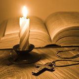 Candle and metal cross Royalty Free Stock Photos