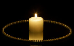 Candle on mirror plate Royalty Free Stock Photo