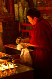 Candle monk of Drepung Monastery Lhasa Tibet Royalty Free Stock Photography