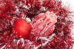 Candle and new-year red ball Royalty Free Stock Image