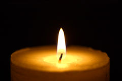 Candle in the night. Close-up view Royalty Free Stock Photos