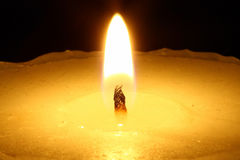 Candle in the night. Close-up view Royalty Free Stock Image