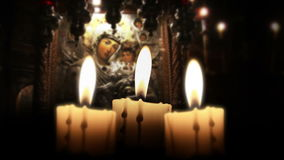 Candle in the night, close up, inside church