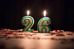 Candle number 26. Twenty six. Lighted candle number twenty six on top of the cake Stock Photo