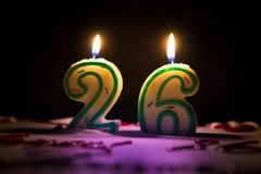 Candle number 26. Twenty six. Lighted candle number twenty six on top of the cake Stock Photography