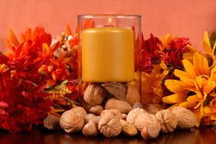 Candle with nuts Stock Photo