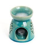 Candle in oil burner Stock Image