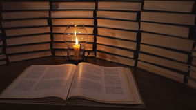 Candle and old books stock footage