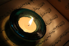 Candle on old note book Stock Images