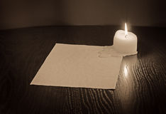 Candle and old paper Stock Image