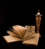 Candle and old papers Royalty Free Stock Image