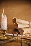 Candle and old roll of paper Royalty Free Stock Photography