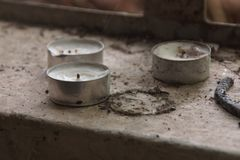 Candle in a old school ruin royalty free stock photography