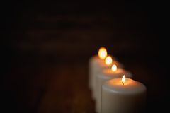 Candle on old wooden background.  Royalty Free Stock Images