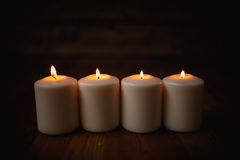 Candle. On old wooden background Stock Photos