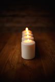 Candle on old wooden background.  Stock Photography