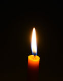 Candle. One candle flame at night closeup - isolated Stock Images