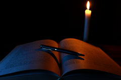 Candle, Opened book and Pencil Royalty Free Stock Photography