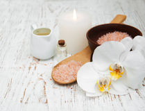Candle, orchids and sea salt Stock Image