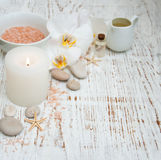Candle, orchids and towels Stock Image
