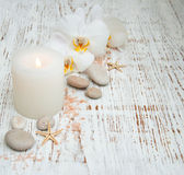 Candle, orcids and stones Royalty Free Stock Photography